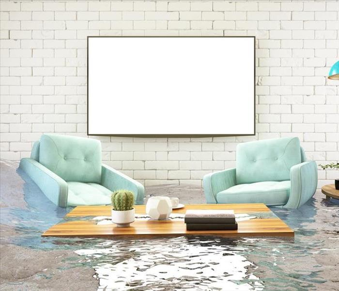 A living room with standing water damage.