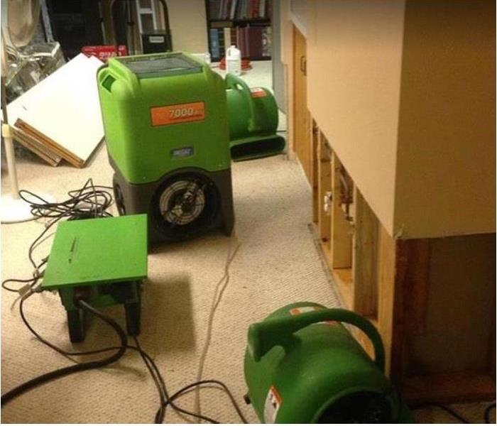 SERVPRO drying equipment being used in water damaged room